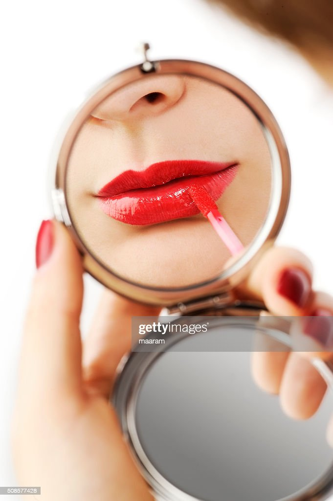 beautiful woman make up with a hand mirror : Stock Photo