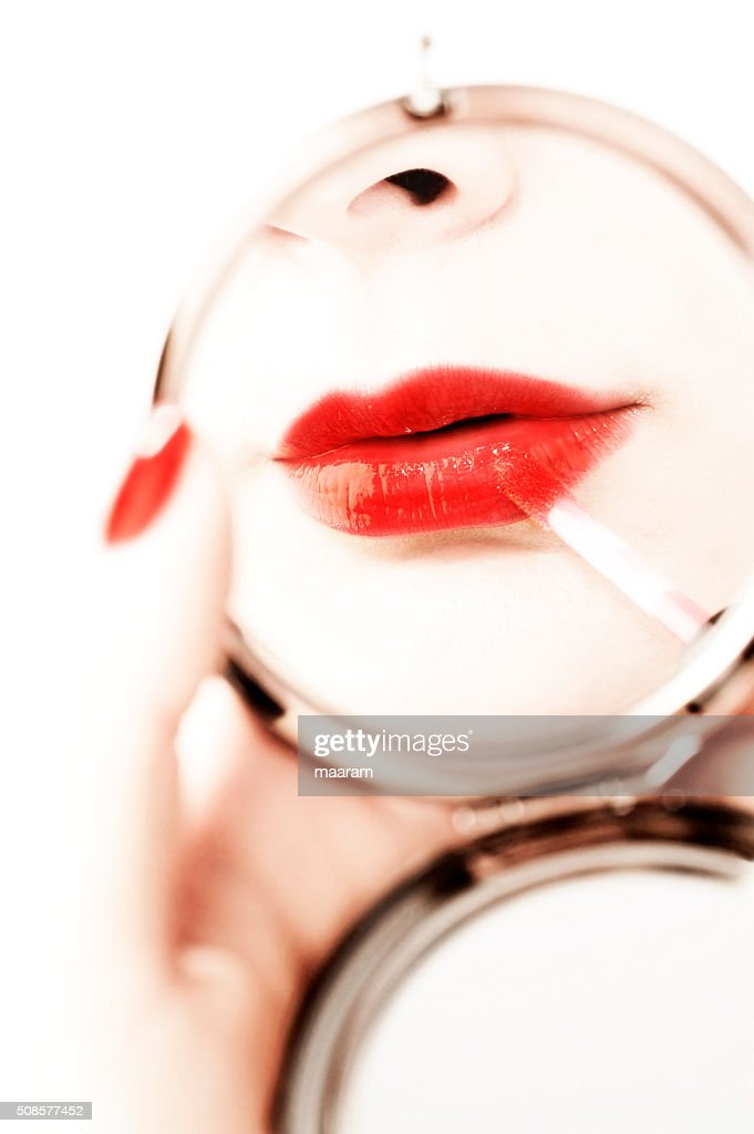 beautiful woman make up with a hand mirror : Bildbanksbilder