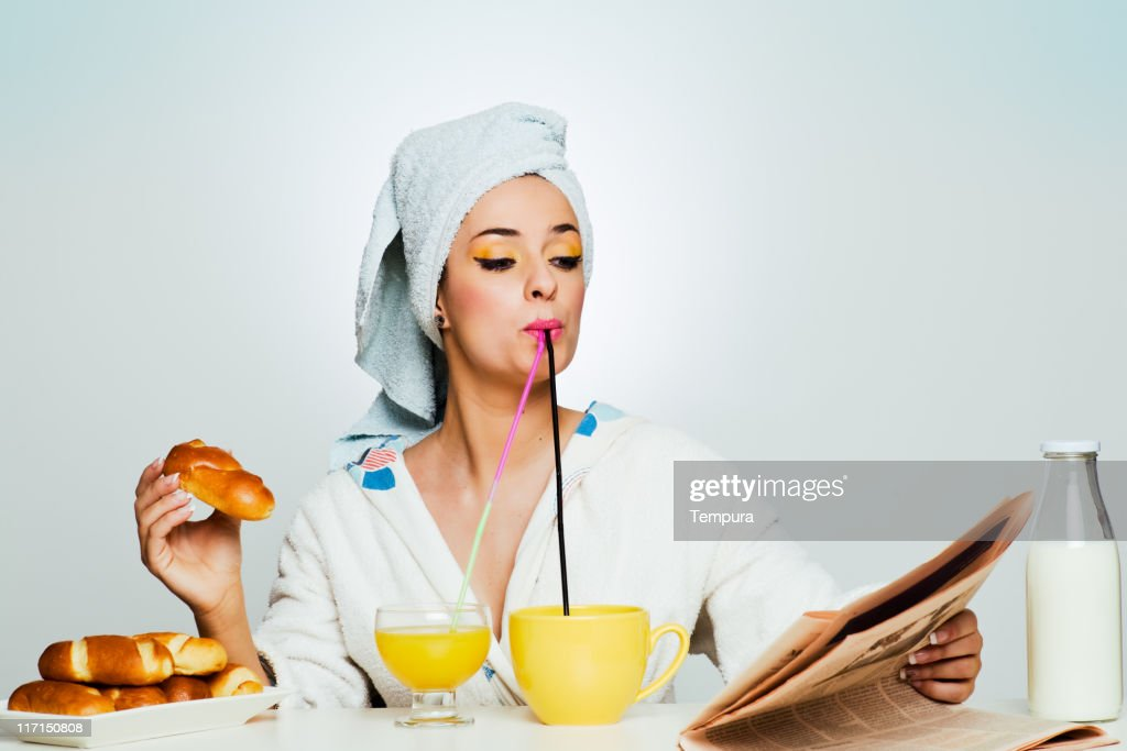 Beautiful woman multiple-tasking breakfast. : Stock Photo