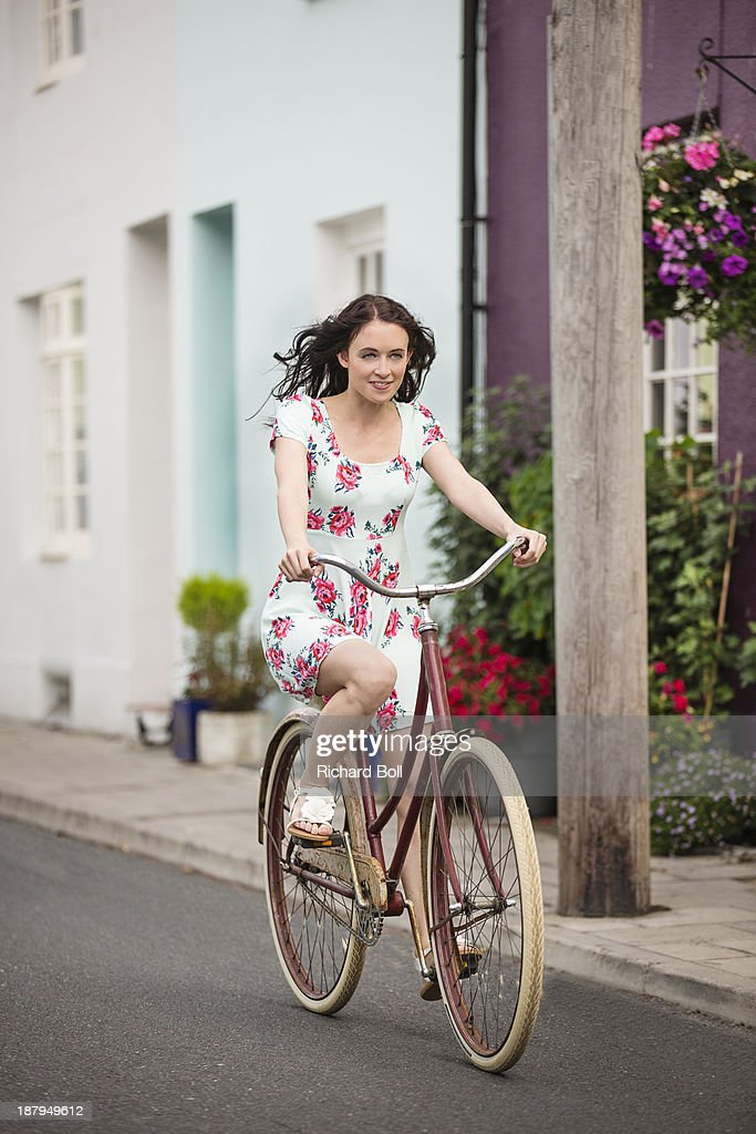 A beautiful woman on a bicycle