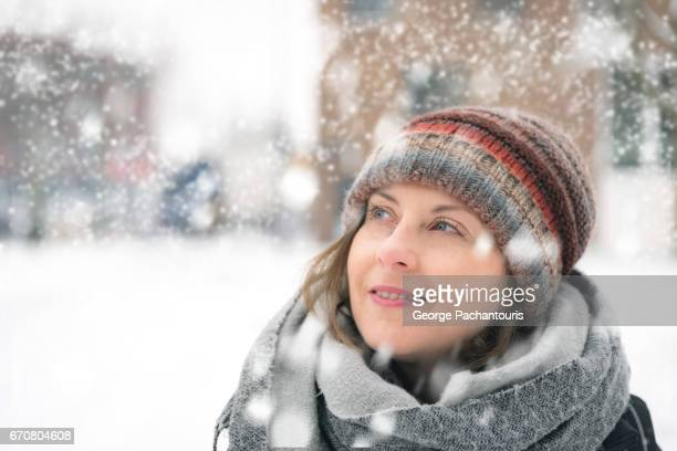 Beautiful woman on a cold day with snow