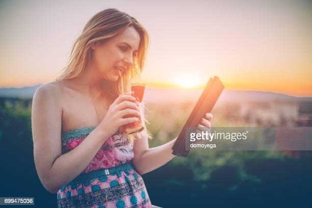 Beautiful woman on a summer day drinking watermelon juice