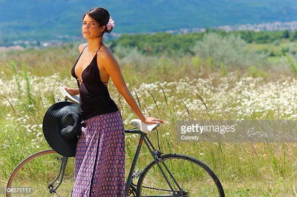 Beautiful woman on a summer field