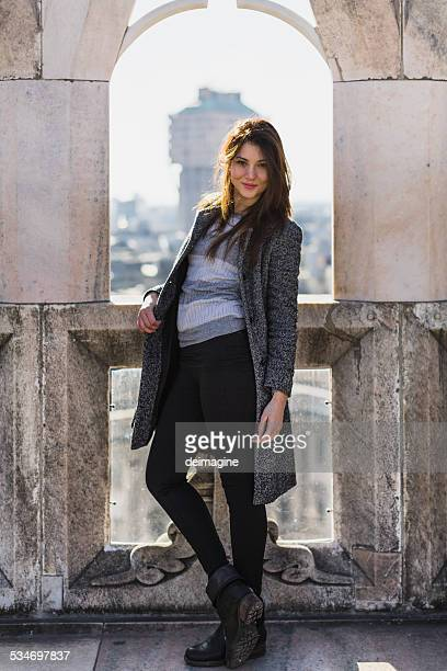 Beautiful woman on the roofs of Milan Duomo