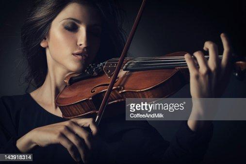Beautiful woman playing on the violin