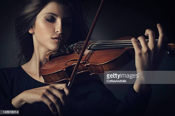 Beautiful woman playing on the violin