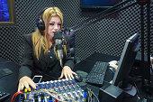 Beautiful DJ Serious Working As Radio Live In Studio