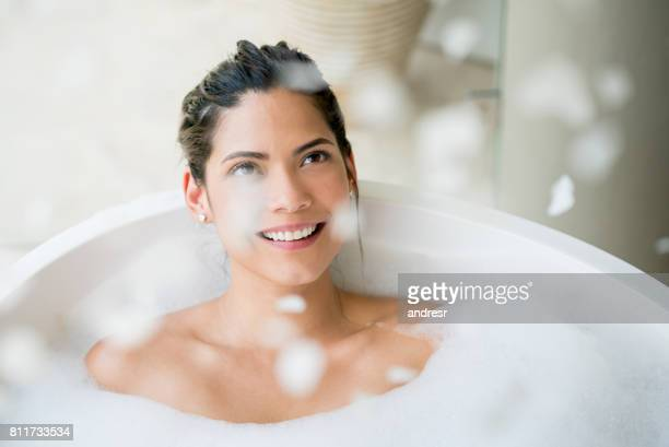 Beautiful woman relaxing and taking a bath