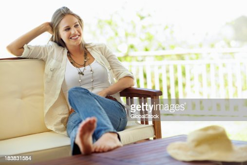 Beautiful woman relaxing on a porch
