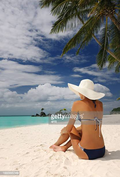 Beautiful Woman relaxing on a White Sand Beach