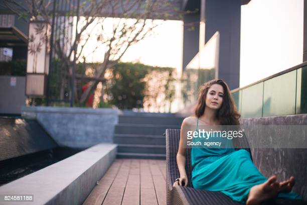 Beautiful woman relaxing on deck chair