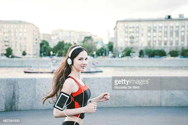 Beautiful Woman Running And Listening To Her Favorite Music