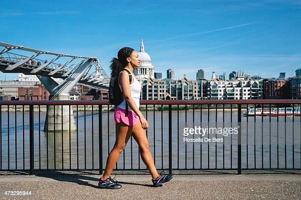 Beautiful Woman Running In City Street