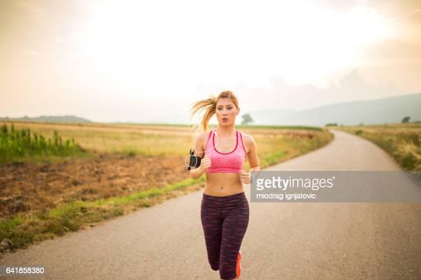 Beautiful woman running outdoors