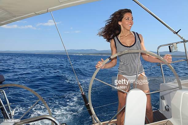 Beautiful woman sailing