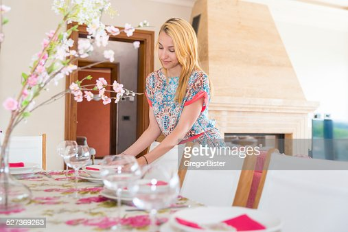 Beautiful woman set the table for lunch