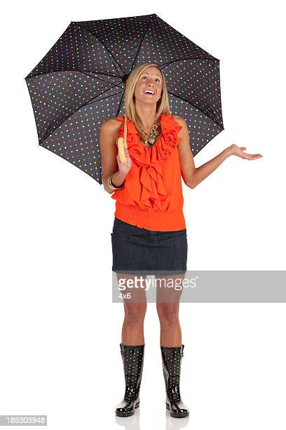 Beautiful woman sheltering under an umbrella