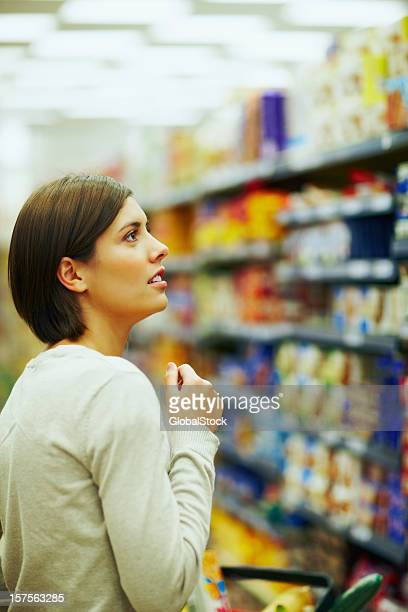 Beautiful woman shopping at the supermarket