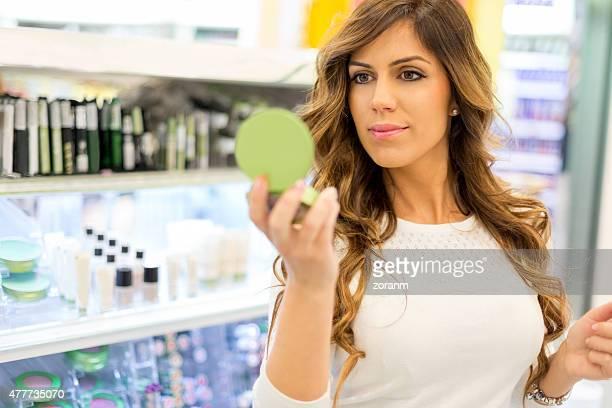 Beautiful woman shopping in make-up department