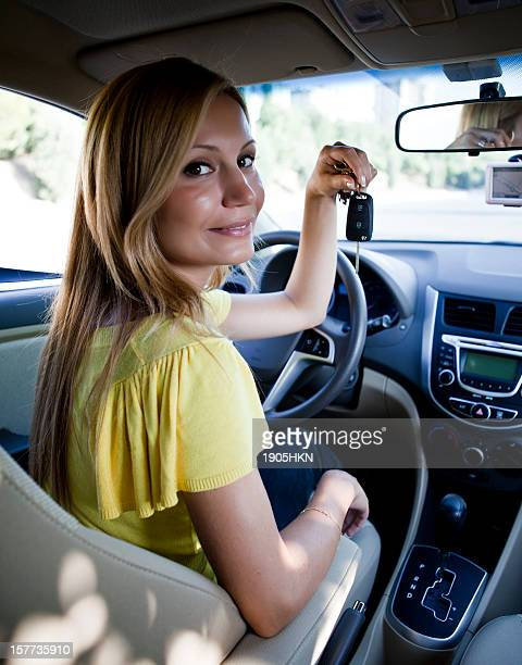 beautiful woman showing car key