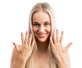Beautiful young woman showing her hands after a manicure