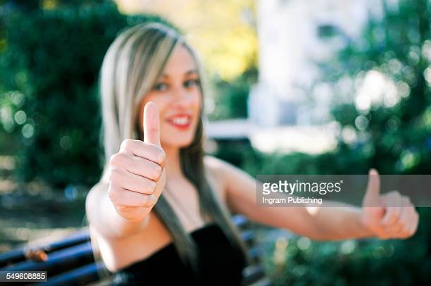 Beautiful woman showing thumbs up sign
