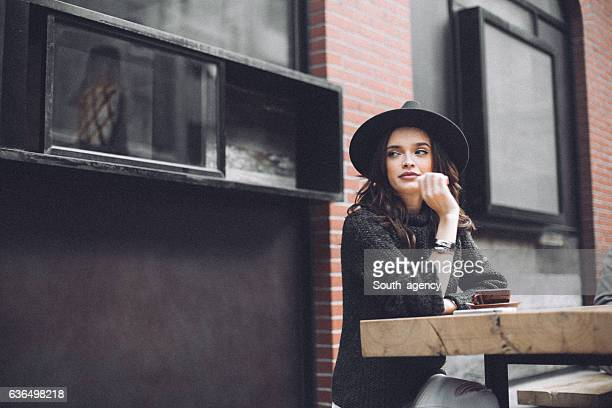 Beautiful woman sitting in a cafe alone