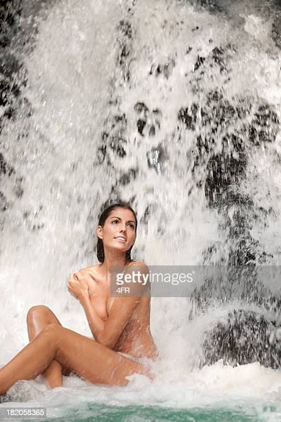 Beautiful woman sitting in a Waterfall Spa (XXXL)