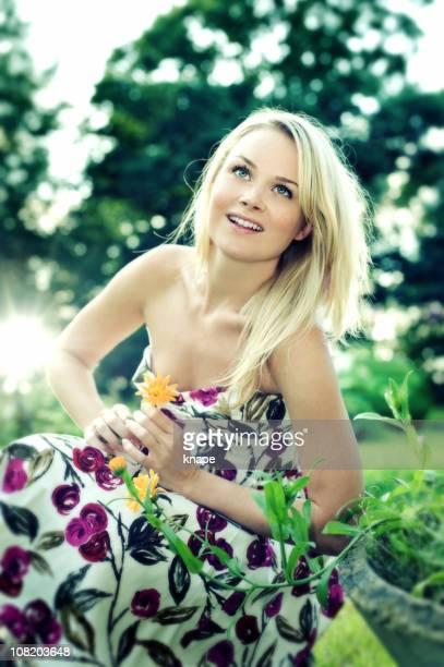 Beautiful woman sitting in garden