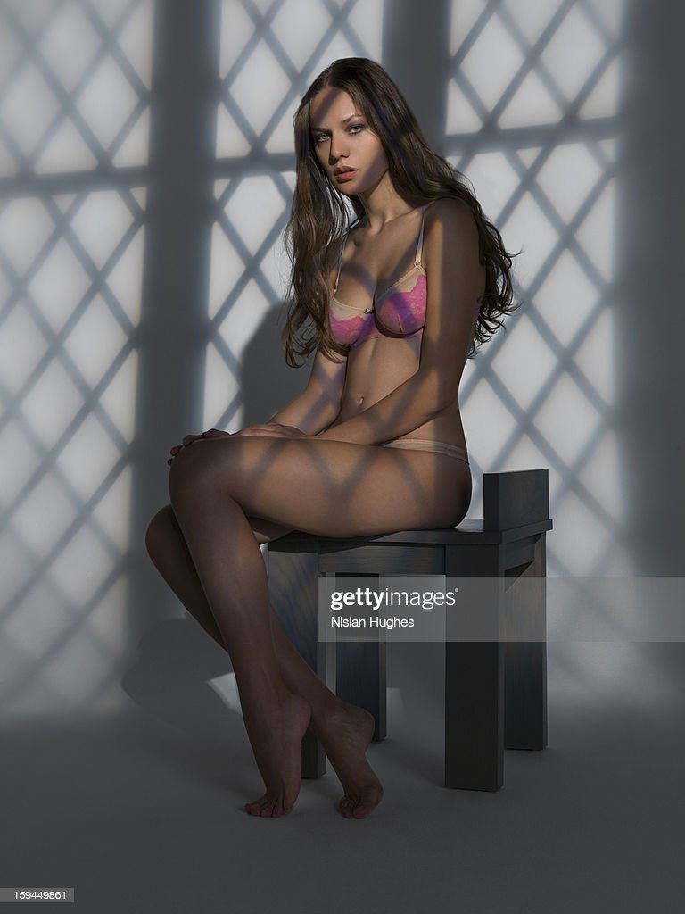Beautiful woman sitting in lingerie : Stock Photo