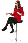 Beautiful woman sitting on stool