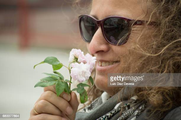 Beautiful woman smelling a Pink Cherry Blossom