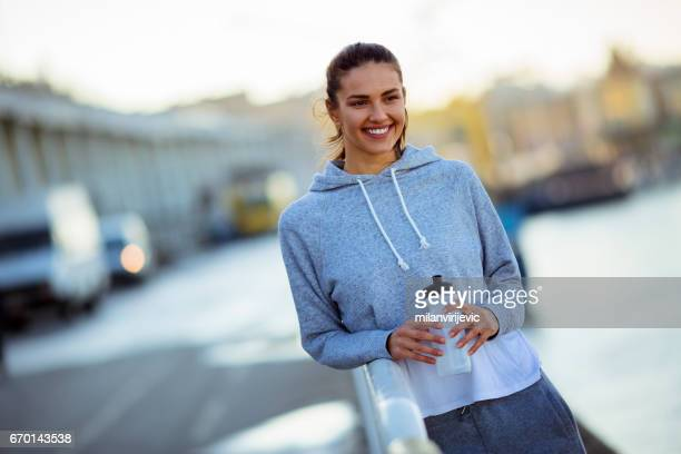 Beautiful woman smiling after running