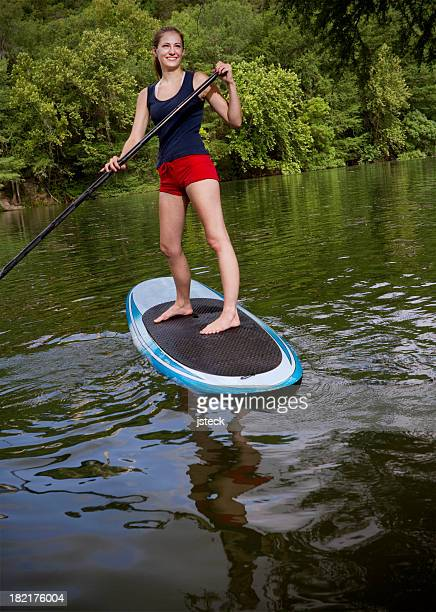 Beautiful Woman Stand Up Paddling