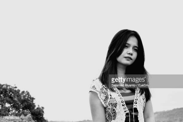 Beautiful Woman Standing Against Clear Sky