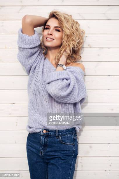 Beautiful woman standing against wall