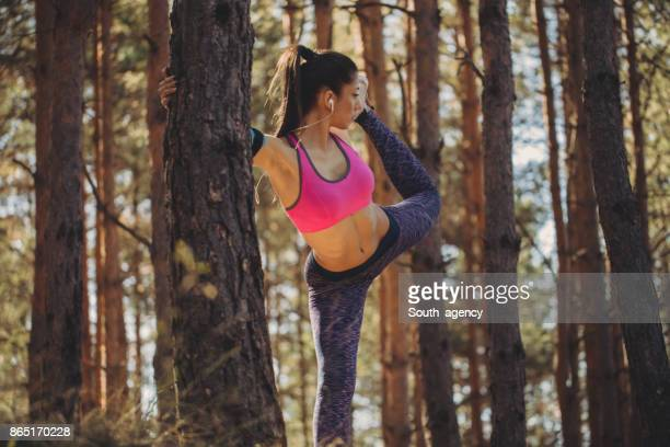 Beautiful woman stretching in nature