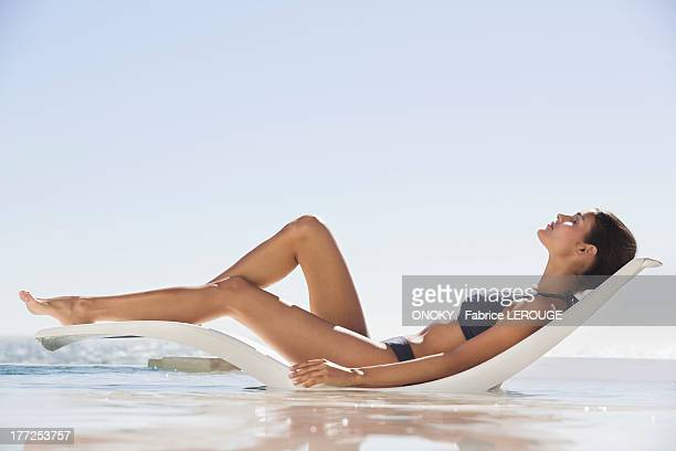 Beautiful woman sunbathing on the beach