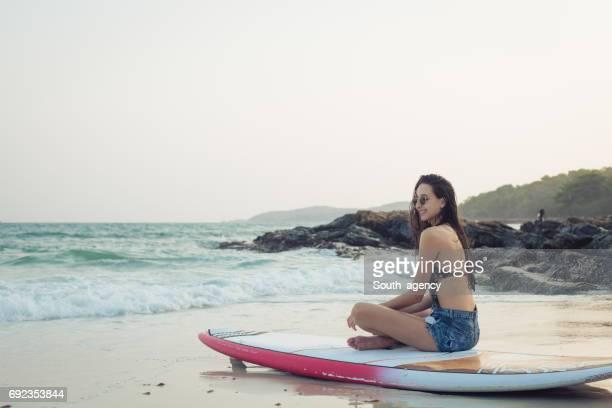 Beautiful woman surfer