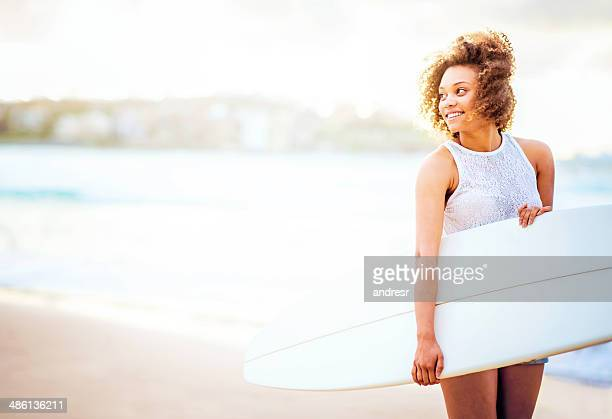 Beautiful woman surfing