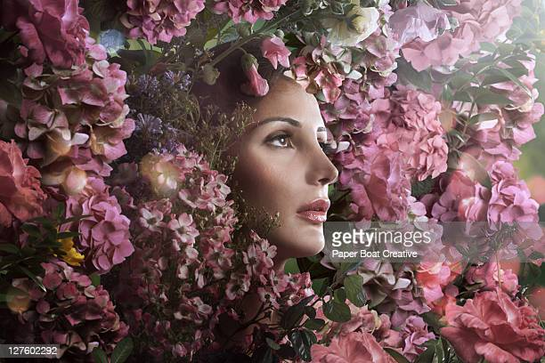 Beautiful woman surrounded by pink flowers