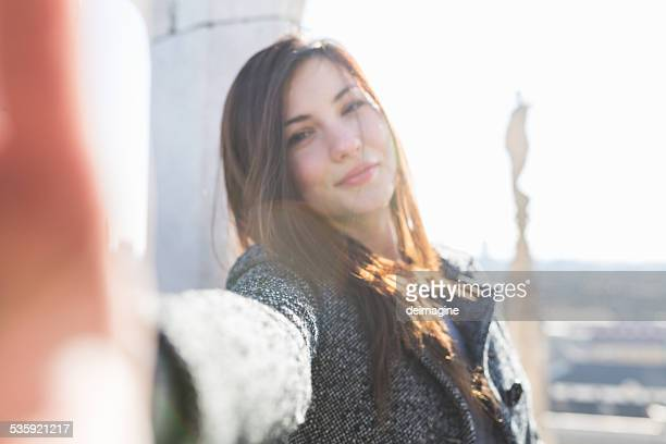 Beautiful woman takes a selfie