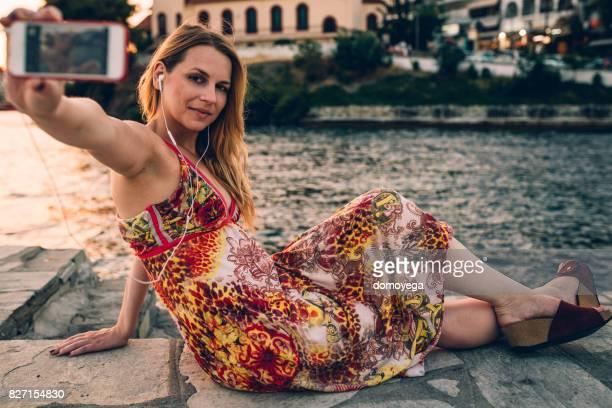 Beautiful woman taking selfie on vacation