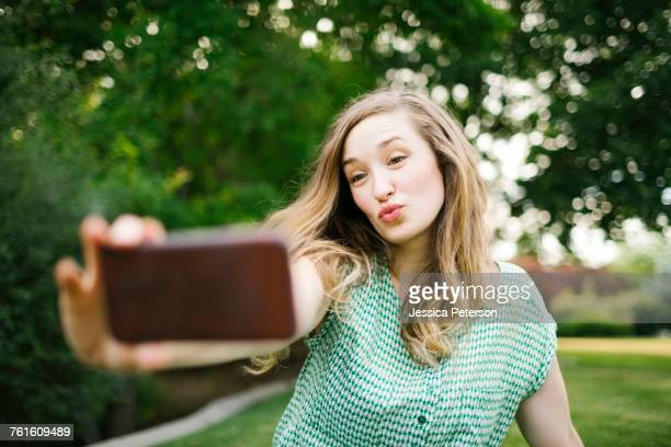 Beautiful woman taking selfie