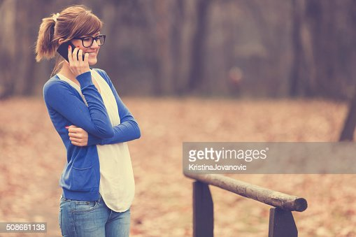 Beautiful woman talking on her cellphone. : Stock Photo