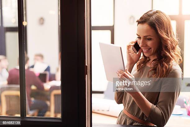 Beautiful woman talking on the mobile phone at the office. Rzeszow, Poland
