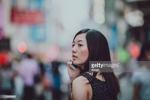 Beautiful woman talking to her smartphone