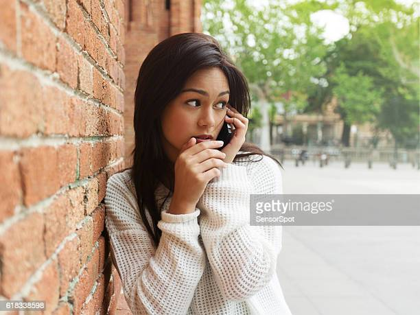 Beautiful woman talking using a smartphone