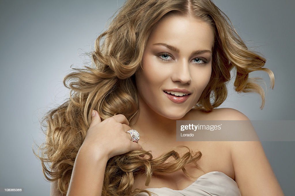 beautiful woman touching her hair : Stock Photo