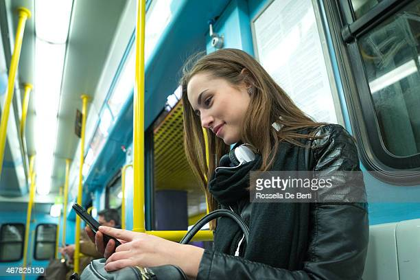 Beautiful Woman Using Her Cell Phone On Subway Train